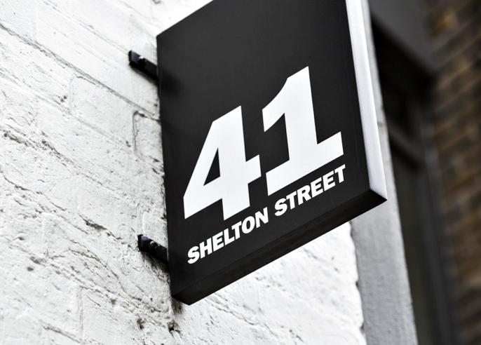 signage, street sign, black sign